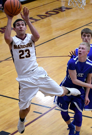 Dieterich's Ryan Radloff goes up for a layup in front of a pair of Martinsville defenders at the Class 1A Dieterich Regional Tuesday night. <br /> Chet Piotrowski Jr./Piotrowski Studios