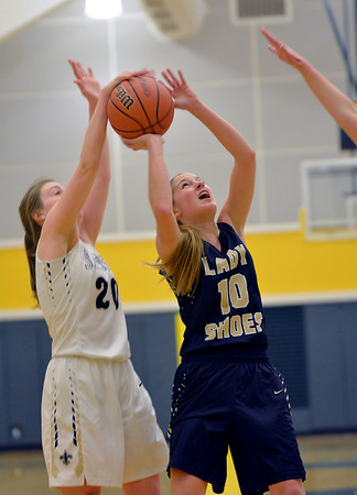 Teutopolis' Sadie Bueker gets her shot blocked by Bloomington Central Catholic's Sarah Brady in the Class 2A Parkland College Super-Sectional.