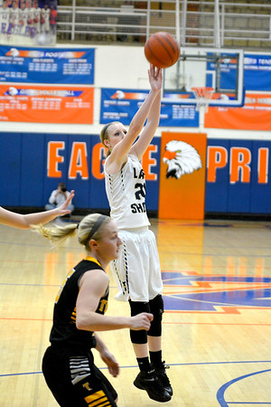 Teutopolis' Jamie Sandschafer shoots a jumper during the Lady Shoes' win over Tuscola at the Class 2A Newton Sectional.