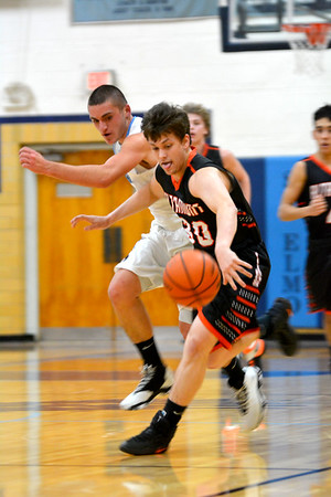 Altamont's Ryan Armstrong races St. Elmo/Brownstown's Klayton Kroll for the ball at St. Elmo High School.