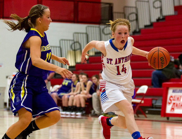 Brownstown/St. Elmo's Dana Shelton tries to catch up with St. Anthony's Clare McHugh as she drives towards the basket after recovering a turnover by the Lady Bombers.