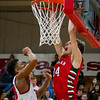 Effingham's Jacob Donaldson lays down a dunk before Mt. Zion's Kevin Cox can defend the basket.