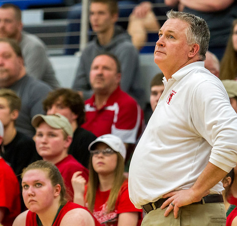 Effingham head coach Jeff Schafer watches as his team puts up its last shot in vain during the Class 3A Decatur MacArthur Sectional semifinal against Mattoon.