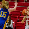 Altamont's Carly McHugh fires from three-point range as Oblong's Summer Johnson rushes to defend the shot.