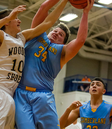 Teutopolis' Brant Bueker, left, and Cumberand's Mike Wolke, center, vie for a rebound as Tyson Magee, right, watches in Pana.