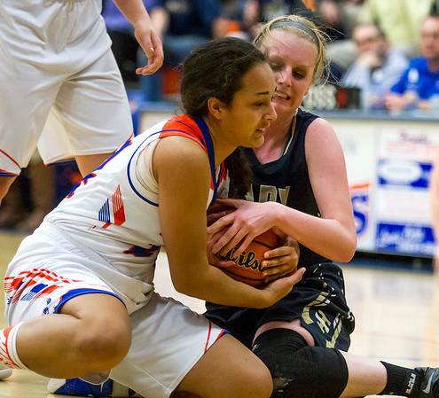 Newton's Ariel Richards, left, and Teutopolis' Jamie Sandschafer, right, battle for possession of the ball at the Class 2A Newton Sectional final.