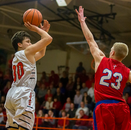 Altamont's Ryan Armstrong prepares to shoot over St. Anthony's Jack Nuxoll Tuesday evening. Armstrong led the Indians in scoring with 25 points despite exiting the game early with his fifth foul.