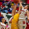 Effingham's Carsyn Fearday, right, goes up for a rebound during the first half against Taylorville, whom the Hearts defeated 61-58 in a comeback on Senior Night.