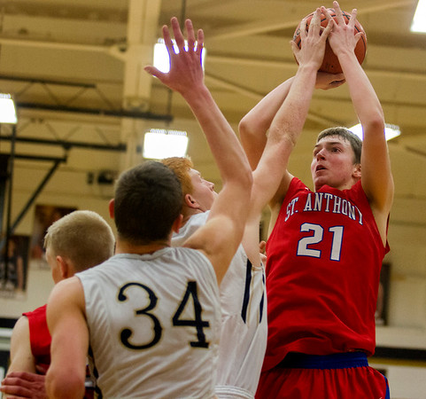 St. Anthony's Adam Levitt pulls up from mid-range while Teutopolis' Lucas Deters gets a hand on the ball.