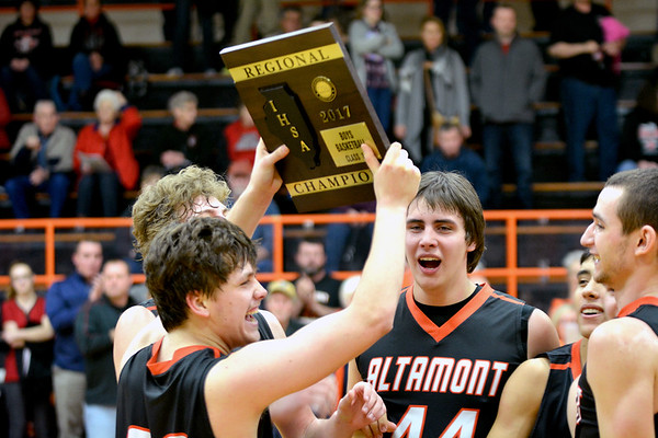 Altamont's Ryan Armstrong holds the Class 1A Altamont Regional championship plaque among his teammates.
