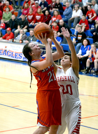 Newton's Abby Frohning puts up a layup in the post against Marshall's Kassidy Evans during the Class 2A Newton Sectional.