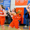 Newton's Kaitlyn Cohorst (center) and Olivia Shipman (15) celebrate while teammates Mariah Earnest (23) and Grace Hartrich (34) walk off the court following Newton's comeback win over Marshall at the Class 2A Newton Sectional.