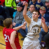 Teutopolis' Mitch Hardiek watches a jumper fly as St. Anthony's Adam Levitt closes in defensively on Feb. 3. Hardiek scored his 1,000th career point in that game.