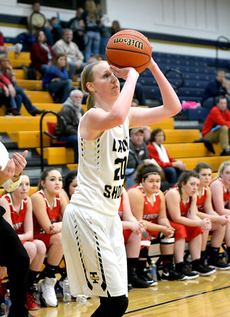 Teutopolis' Jamie Sandschafer spots up from 3-point range in the Class 2A Teutopolis Regional final against Lawrenceville. Sandschafer hit four 3-pointers in the first quarter and finished with 28 points in the title game win.