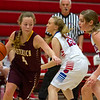 Dieterich's Gracie Britton tries to drive past St. Anthony's Meg Richards during the first half of the regional semifinal, which the Bulldogs won 55-23.