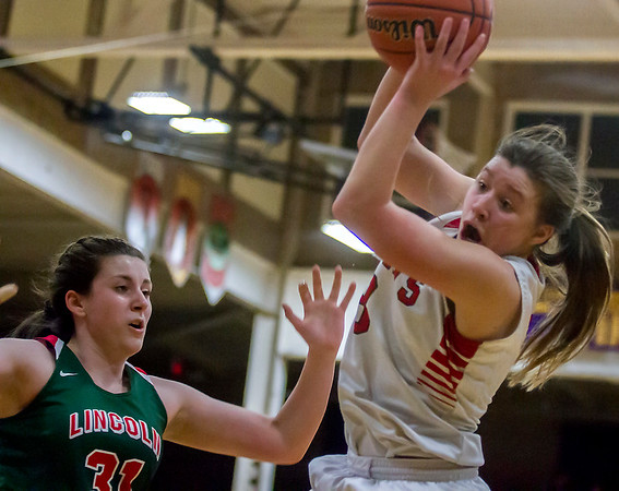 Effingham's Carsyn Fearday grabs a rebound before Lincoln's Leah Schneider can get to it in Taylorville. Fearday finished with 16 points and seven rebounds in the Hearts' 70-64 win over the Railsplitters.