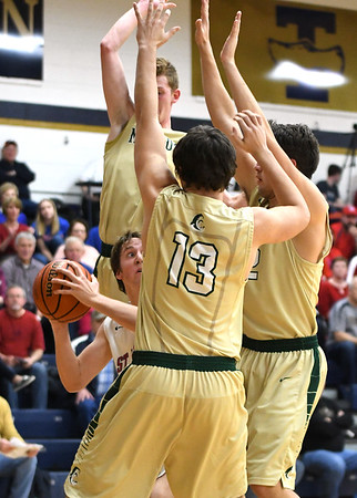 St. Anthony's Alex Beesley looks for an against Mattoon's Davis Johnson (3, behind), Dalton Stephens (13, front) and Justus Donaldson (22, right) during the 5th Annual Wooden Shoes Boys Basketball Shootout.<br /> Chet Piotrowski Jr./Piotrowski Studios