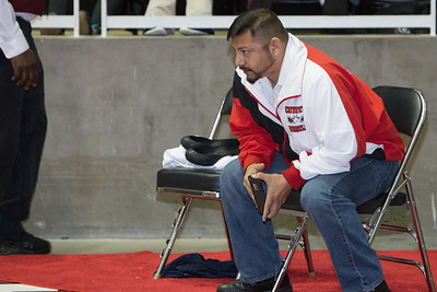 La Joya Wrestling Head Coach Muzquiz coaches his son James during the final day of the Texas UIL State Wrestling Tournament in Garland on Saturday, February 21st, 2015. PAUL BRICK FOR PROGRESS TIMES.