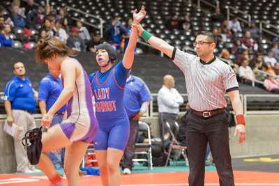 Leslie Alaniz (Mission Veterans) defeated Diana Ontiveros (El Paso Burges) in overtime during preliminary action at the UIL Texas State Wrestling Tournament in Garland on Friday, February 20th, 2015. PAUL BRICK FOR PROGRESS TIMES.