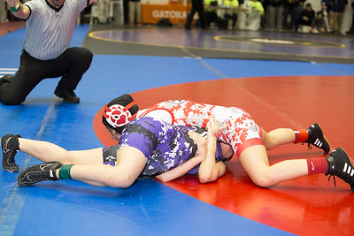Areanna Saldana of Sharyland was defeated by Noemi Godinez of Carrolton Creekview during preliminary action at the UIL Texas State Wrestling Tournament in Garland on Friday, February 20th, 2015. PAUL BRICK FOR PROGRESS TIMES.