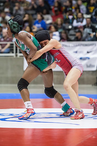 Lesllie Oliva of Juarez Lincoln battled Asia Ray of Arlington Martin but was defeated 6-3 and won the silver medal in the Championship round during the Texas UIL State Wrestling Tournament in Garland on Saturday, February 21st, 2015. PAUL BRICK FOR PROGRESS TIMES.