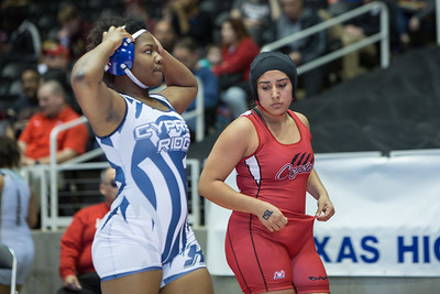 Daisy Ramirez of Juarez Lincoln pinned Brandi Dominguez of Cypress Creek in the 165 pound class, winning 5th place  during the final day of the Texas UIL State Wrestling Tournament in Garland on Saturday, February 21st, 2015. PAUL BRICK FOR PROGRESS TIMES.