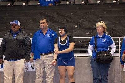Mission Veterans Assistant Coach Jesse Rodriguez, Head Coach Ben Yzaguirre and Athletic Trainer Kim C. Reynolds get ready with Klarissa Blanco during the final day of the Texas UIL State Wrestling Tournament in Garland on Saturday, February 21st, 2015. PAUL BRICK FOR PROGRESS TIMES.