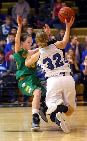 2-9-13<br /> Sectional Girls Finals Eastern HS vs Tipton HS<br /> Eastern's Brittany Neeley and Tipton's Kacie Juday collide. Neeley was called for a foul.<br /> KT photo | Tim Bath
