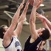 2-25-14<br /> Tipton vs. Cass basketball<br /> Blake Hadley of Lewis Cass shoots over Tipton's Nate Friend.<br /> KT photo | Kelly Lafferty