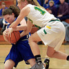 2-11-14<br /> Eastern vs. Tipton basketball<br /> Tipton's Delaney Jones and Eastern's Jessie Sprinkles try to gain repossession of the ball.<br /> KT photo | Kelly Lafferty