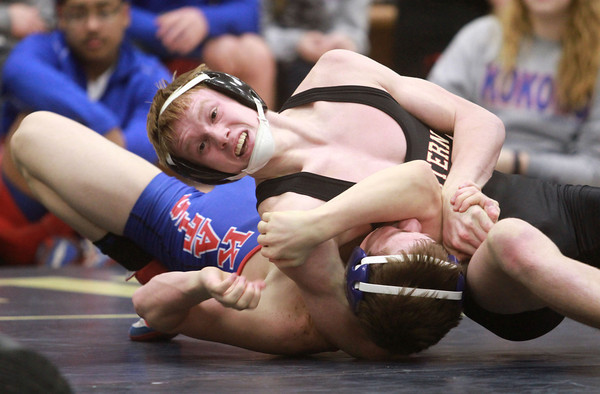 2-1-14<br /> Sectional Wrestling<br /> Western's Caleb Maddox and Kokomo's AJ Nelson in the 120<br /> KT photo   Kelly Lafferty