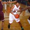 2-27-17<br /> Kokomo vs. Bowman Academy basketball<br /> Kokomo's Demarius Warren looks where to pass the ball past Bowman Academy's defense.<br /> KT photo | Kelly Lafferty