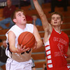 2-26-14<br /> Northwestern vs. Mississinewa basketball<br /> Northwestern's Jacob Wagner looks to the basket as Mississinewa's Ben Stevens tries to block.<br /> KT photo | Kelly Lafferty