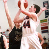 2-7-14<br /> Cass vs. Peru basketball<br /> Blake Hadley of Lewis Cass goes up for a shot as Peru's Paul Huneryager tries to block him.<br /> KT photo | Kelly Lafferty
