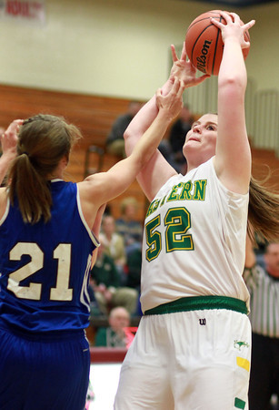 2-11-14<br /> Eastern vs. Tipton basketball<br /> Eastern's Jennifer Keith grabs the rebound and tries to go up for another shot as Tipton's Lela Crawford tries to block her.<br /> KT photo | Kelly Lafferty
