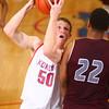 2-27-17<br /> Kokomo vs. Bowman Academy basketball<br /> Kokomo's Erik Bowen looks past Bowman Academy's Justin King toward the basket.<br /> KT photo | Kelly Lafferty