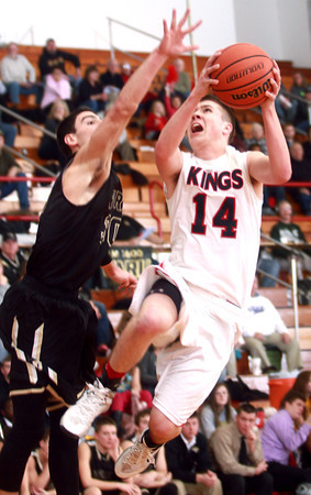 2-7-14<br /> Cass vs. Peru basketball<br /> Ryan Bixler of Lewis Cass goes up for a shot as Peru's Michael Richardson tries to block it.<br /> KT photo | Kelly Lafferty