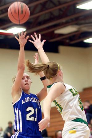 2-11-14<br /> Eastern vs. Tipton basketball<br /> Tipton's Lela Crawford puts up a shot as Eastern's Emily Richards tries to block her.<br /> KT photo | Kelly Lafferty