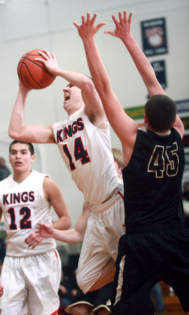 2-7-14<br /> Cass vs. Peru basketball<br /> Ryan Bixler of Lewis Cass goes up for a shot as Peru's Kordell Prescott tries to block it.<br /> KT photo | Kelly Lafferty