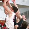 2-7-14<br /> Cass vs. Peru basketball<br /> Austin Keisling of Lewis Cass goes up for a rebound against Peru's defenders.<br /> KT photo | Kelly Lafferty