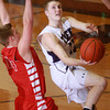 2-26-14<br /> Northwestern vs. Mississinewa basketball<br /> Northwestern's Logan Galbraith goes for the basket as Mississinewa's Sam Cerny blocks.<br /> KT photo | Kelly Lafferty