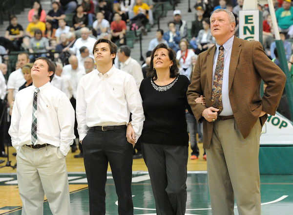 MSSU Head Coach Robert Corn, right, watches a video tribute with his family before the start of his last home game on Saturdasy at Leggett & Platt. Pictured from the left : Corn's sons, Scott Corn and Rob Corn and his wife, Cindy Corn.<br /> Globe | Laurie Sisk