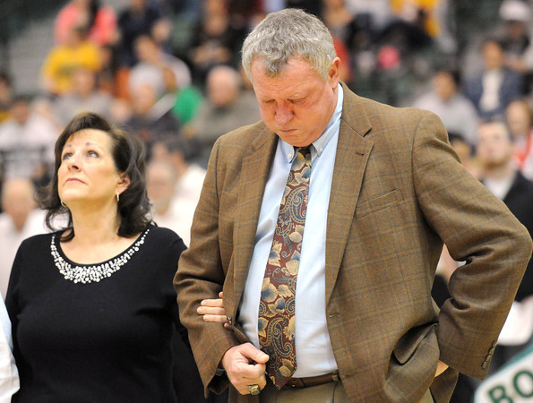MSSU Head Coach Robert Corn, right, tries to contain his emotion as he stands arm-in-arm with his wife Cindy during a video tribute on Saturday at Leggett & Platt. <br /> Globe | Laurie Sisk