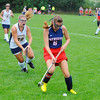 North Middlesex' Jordan O'Brien controls the ball along the sideline as Littleton's Hannah Montemagno gives chase during Saturday's Field Hockey Play Day at St. Bernard's in Fitchburg.<br /> SENTINEL & ENTERPRISE / BRETT CRAWFORD