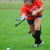 Fitchburg's Florencia Rivas hits the ball upfield during Saturday's Field Hockey Play Day at St. Bernard's field in Fitchburg.<br /> SENTINEL & ENTERPRISE / BRETT CRAWFORD