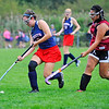 North Middlesex' Emily Rapoza (left) controls the ball as Fitchburg's Elizabeth Phounsaly gives chase during Saturday's Field Hockey Play Day at St. Bernard's in Fitchburg.<br /> SENTINEL & ENTERPRISE / BRETT CRAWFORD