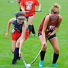 North Middlesex' Marie Shepherd (left) and Fitchburg's Julie Fluet battle for possession of the ball during Saturday's Field Hockey Play Day at St. Bernard's in Fitchburg.<br /> SENTINEL & ENTERPRISE / BRETT CRAWFORD