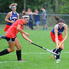 Fitchburg's Eva Robichaud (left) gives chase as North Middlesex' Hayley Lynch brings the ball down field during Saturday's Field Hockey Play Day at St. Bernard's in Fitchburg.<br /> SENTINEL & ENTERPRISE / BRETT CRAWFORD
