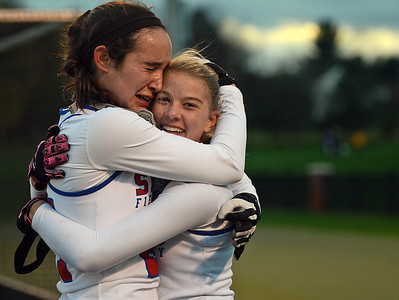 Selinsgrove Seals' Nora Aucker and Emily Klingler celebrate Klingler game clinching goal against the Line Mountain Eagles for the D4 field hockey championship in Lewisburg on Thursday night.