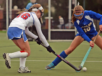 Line Mountain Eagles' Paige Adams attempts to block Selinsgrove Seals' MacKenna Mahan during the D4 field hockey championship game in Lewisburg on Thursday night. Selinsgrove won the game 3--2 in overtime.